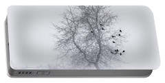 Crows On Tree In Winter Snow Storm Portable Battery Charger by Peter v Quenter