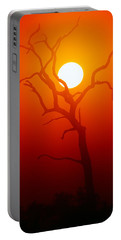 Dead Tree Silhouette And Glowing Sun Portable Battery Charger