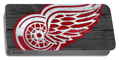 Detroit Red Wings Recycled Vintage Michigan License Plate Fan Art On Distressed Wood Portable Battery Charger by Design Turnpike