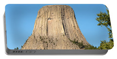 Portable Battery Charger featuring the photograph Devils Tower by John M Bailey