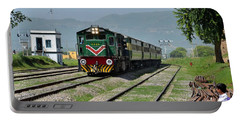 Portable Battery Charger featuring the photograph Diesel Electric Locomotive Speeds Past Student by Imran Ahmed