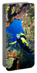 Divers Looks Into Cozumel Crevice Portable Battery Charger