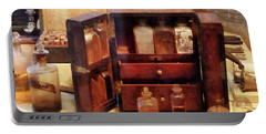 Portable Battery Charger featuring the photograph Doctor - Case With Medicine Bottles by Susan Savad