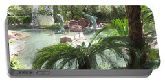 Dolphin Pond And Garden Green Portable Battery Charger by Navin Joshi