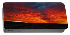Portable Battery Charger featuring the photograph Dramatic Sunrise by Lynn Hopwood