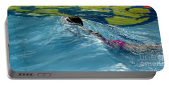 Ducking Under A Wave In A Pool Portable Battery Charger by Kerri Mortenson