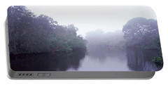 Early Morning Fog On A Creek, South Portable Battery Charger by Panoramic Images