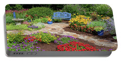 Elevated View Of A Flower Garden Portable Battery Charger