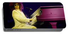 Elton Portable Battery Charger by David Plastik