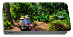 Loving Couple Enjoying Their Prayer Garden Portable Battery Charger