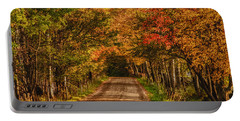 Fall Color Along A Dirt Backroad Portable Battery Charger by Jeff Folger