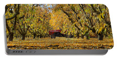 Fall In The Peach Orchard Portable Battery Charger by Jim And Emily Bush