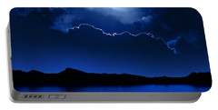 Fantasy Moon And Clouds Over Water Portable Battery Charger by Johan Swanepoel