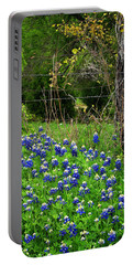 Fenced In Bluebonnets Portable Battery Charger by David and Carol Kelly