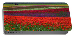 Field Of Tulips Portable Battery Charger by Jordan Blackstone