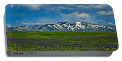 Field Of Wildflowers Portable Battery Charger by Don Schwartz