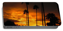 Portable Battery Charger featuring the photograph Fiery Sunset by Deb Halloran