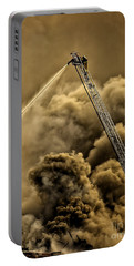 Portable Battery Charger featuring the photograph Firefighter-heat Of The Battle by David Millenheft