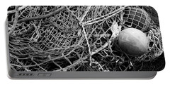 Portable Battery Charger featuring the photograph Fishing Nets And Floats Monochrome by Jane McIlroy