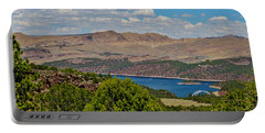 Portable Battery Charger featuring the photograph Flaming Gorge by Janice Rae Pariza