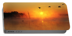 Flight At Sunrise Portable Battery Charger by Roger Becker