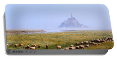 Flock Of Sheep In A Field With Mont Portable Battery Charger
