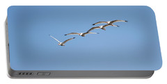 Portable Battery Charger featuring the photograph Flying Formation by John M Bailey
