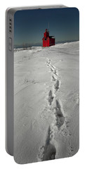 Footprints Leading From The Lighthouse Big Red During Winter Portable Battery Charger by Randall Nyhof