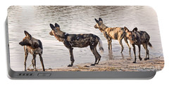 Portable Battery Charger featuring the photograph Four Alert African Wild Dogs by Liz Leyden