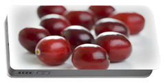 Portable Battery Charger featuring the photograph Fresh Cranberries Isolated by Lee Avison