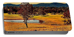 Portable Battery Charger featuring the photograph From A Distance by Wallaroo Images