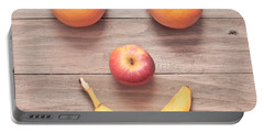 Fruit Face Portable Battery Charger by Tom Gowanlock