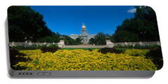 Garden In Front Of A State Capitol Portable Battery Charger