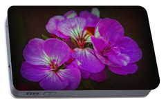 Portable Battery Charger featuring the photograph Geranium Blossom by Hanny Heim