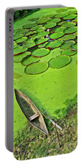 Giant Water Lilies And A Dugout Canoe In Amazon Jungle-peru Portable Battery Charger