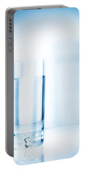 Glass Of Water On Light Blue Background Portable Battery Charger