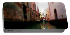 Portable Battery Charger featuring the photograph Gliding Along The Canal  by Micki Findlay