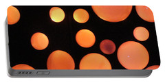 Glowing Orange Portable Battery Charger by Tiffany Erdman