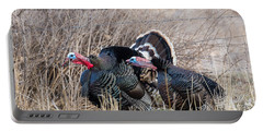 Portable Battery Charger featuring the photograph Gobbling Turkeys by Michael Chatt