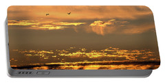 Portable Battery Charger featuring the photograph Golden Clouds by AJ  Schibig