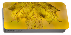 Portable Battery Charger featuring the photograph Golden Maple Leaf by Sebastian Musial