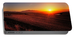 Golden Sunrise Over Farmland Portable Battery Charger