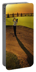 Golfer Taking A Swing From A Golf Bunker Portable Battery Charger