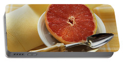 Grapefruit Half With Grapefruit Spoon In A Bowl Portable Battery Charger