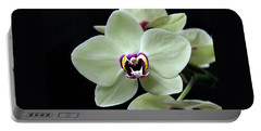 Green Hybrid Phalaenopsis Flower With A Red Wine Center Portable Battery Charger by William Tanneberger