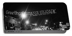 Greetings From Asbury Park New Jersey Black And White Portable Battery Charger by Terry DeLuco
