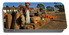 Portable Battery Charger featuring the photograph Guarding The Pumpkin Patch by Michael Gordon