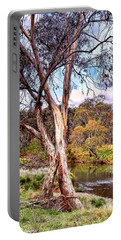 Portable Battery Charger featuring the photograph Gum Tree By The River by Wallaroo Images