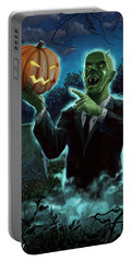 Portable Battery Charger featuring the painting Halloween Ghoul Rising From Grave With Pumpkin by Martin Davey