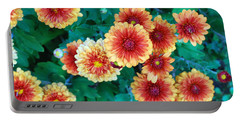 Portable Battery Charger featuring the photograph Happy Faces. Fall Mums In Orange And Yellow by Connie Fox